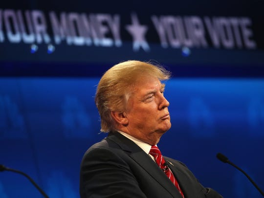 Donald Trump pauses during the CNBC Republican presidential