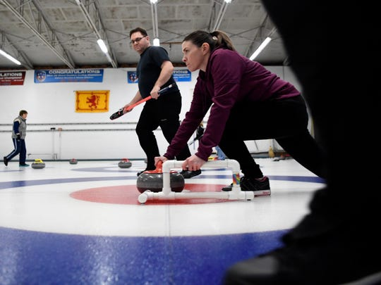 Cristin Keegan, center, of Mahwah, throws the curling