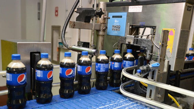 Bottles of Pepsi come off the line at the bottling plant in Salisbury.