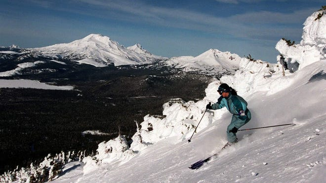 A skier works her way down Mount Bachelor Ski Area near Bend,