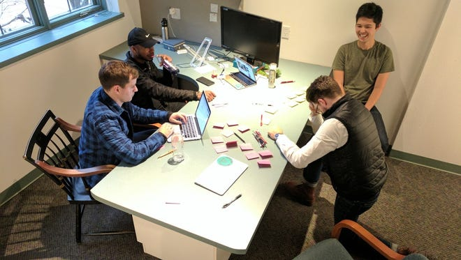 Niko Skievaski (top right) with some of the employees at Redox in the startup's office in Madison.