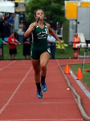 Oak Harbor's Elayna Krupp runs in the girls 800 meter relay Friday, June 1, 2018, during the state track and field championship at Jesse Owens Memorial Stadium in Columbus.