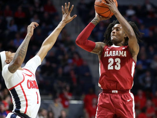 Feb 22, 2020; Oxford, Mississippi, USA; Alabama Crimson Tide guard John Petty Jr. (23) shoots against the Mississippi Rebels during the first half at The Pavilion at Ole Miss. Mandatory Credit: Petre Thomas-USA TODAY Sports