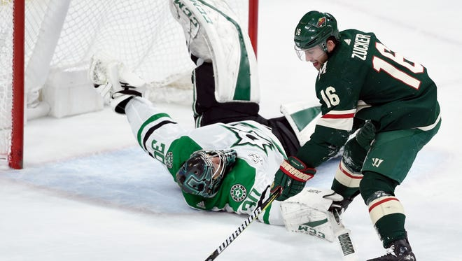 Dallas Stars goalie Ben Bishop (30) trips Minnesota Wild's Jason Zucker (16) while shooting during the third period of an NHL hockey game Wednesday, Dec. 27, 2017, in St. Paul, Minn. Bishop was called for a penalty on the play. The Wild won 4-2. (AP Photo/Hannah Foslien)