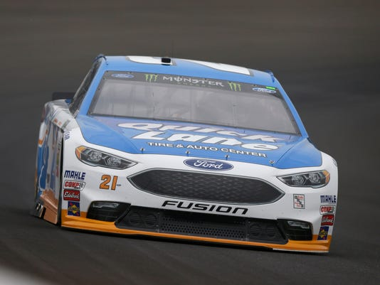 Race driver driver Ryan Blaney (21) drives through the first turn during practice for the NASCAR auto race at Indianapolis Motor Speedway, in Indianapolis Saturday, July 22, 2017. (AP Photo/Michael Conroy)