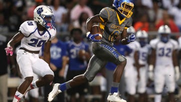 Video: Faith and football collide at Godby, Rickards game