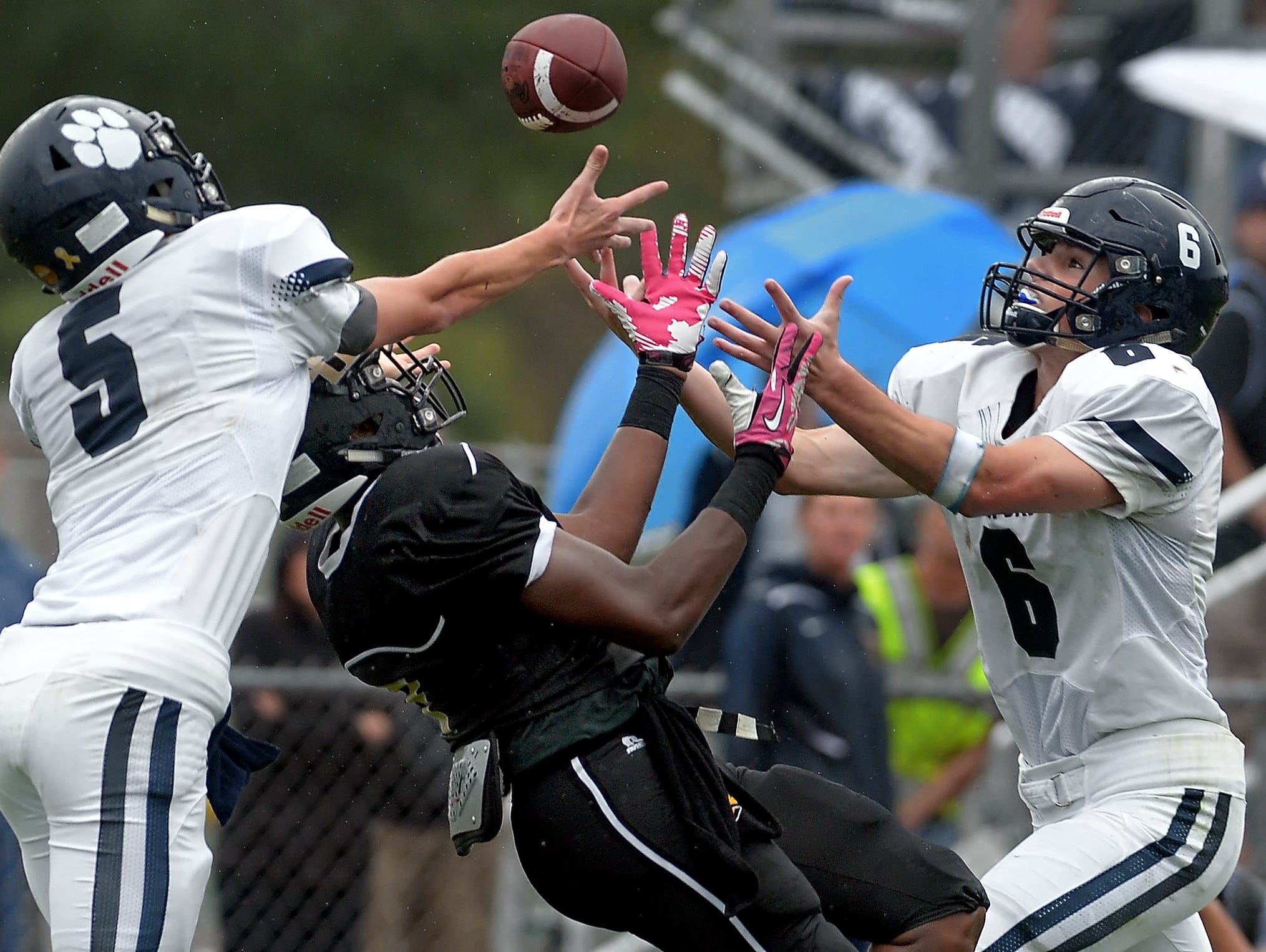 Pittsford's Michael Gigantelli, right at Rush-Henrietta on Sept. 19, made 13 tackles against Fairport a week later..