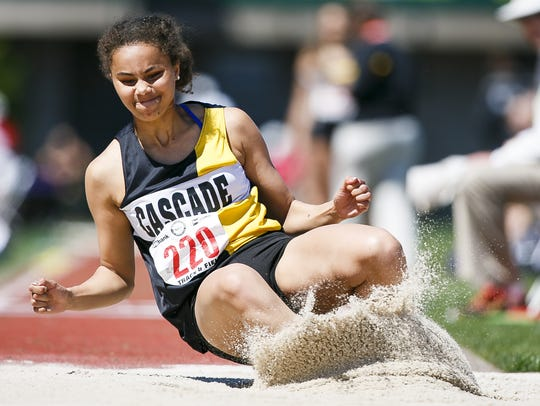 Cascade's Kalulu Ngaida competes in the triple jump