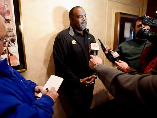 Florida State interim coach Odell Haggins talks to