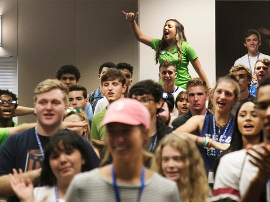 Florida Gulf Coast University incoming freshmen are taught the FGCU chant by orientation leaders including, Sierra Amato, (top) during a Welcome to the Nest orientation on July 13.