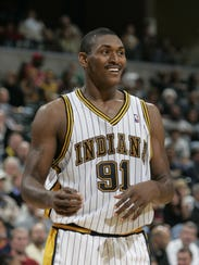 10/19/04.  Ron Artest, of the Pacers, smiles at a teammate
