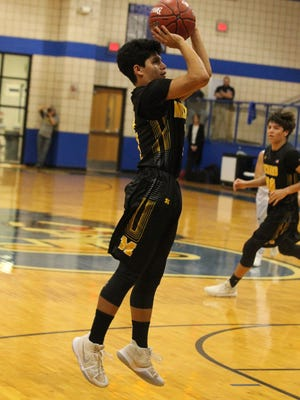Menard High School's Noah Rosas gets ready to shoot against Bronte in a Class 1A Region II regional quarterfinal basketball playoff at the Coleman gym on Tuesday, Feb. 27, 2018.