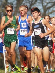 Covington Catholic sophomore Casey Wolnitzek, middle, runs in 3A.   KHSAA State cross country meet. Class 3A. Kentucky Horse Park. Nov. 5, 2016. Lexington KY.