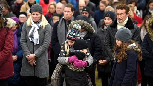 Children embrace during at a vigil Nov. 15, 2015, at Nepean Point, in Ottawa, Canada, on Sunday, Nov. 15, 2015, where people gathered to honor the victims of Friday's attacks in Paris.