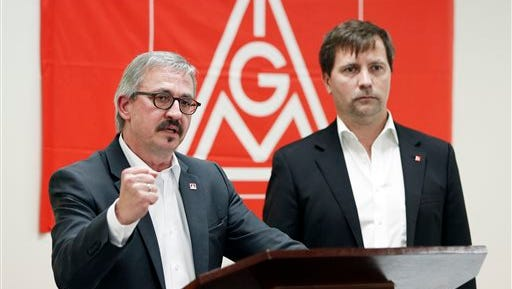 Wolfgang Lemb, left, of the German trade union IG Metall's executive board, speaks during a news conference Thursday in Spring Hill, Tenn. The United Auto Workers and German counterpart IG Metall will open a joint office to promote unionization among manufacturers and suppliers in the South. At right is Soeren Niemann-Findeisen, also of IG Metall.