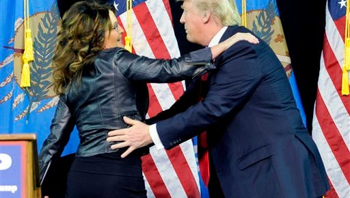 Former Republican vice presidential candidate Sarah Palin hugs Republican presidential candidate Donald Trump during a rally held at the Mabee Center in Tulsa, Okla., Wednesday, Jan 20, 2016.