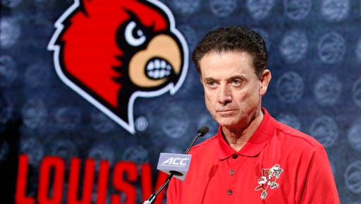 Louisville NCAA college basketball head coach Rick Pitino answers a question during the Atlantic Coast Conference men's media day in Charlotte, N.C., Wednesday, Oct., 26, 2016. (AP Photo/Bob Leverone)