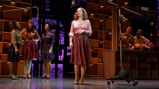 """In this image released by The O and M Company, Jessie Mueller as Carole King, center, performs in """"Beautiful: Carol King the Musical,"""" in New York. Producers said Friday that a London production is due to start and a national tour across America is planned."""