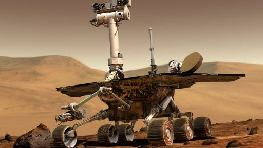 This artist rendering released by NASA shows the NASA rover Opportunity on the surface of Mars.