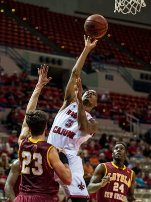 Ragin' Cajuns guard Tyrone Wooten (3), shown here shooting against Loyola of New Orleans, is leaving the UL basketball team.