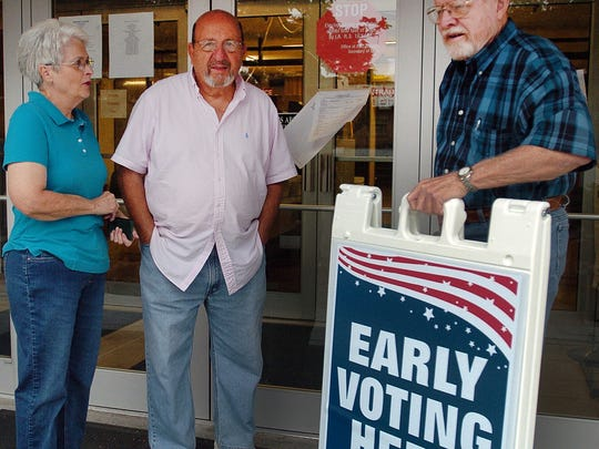 Sam and Pat Cypriano talk with Tommy Hidalgo as they await the start of early voting Saturday at the St. Landry Parish Courthouse. See a photo gallery at dailyworld.com and on Facebook.