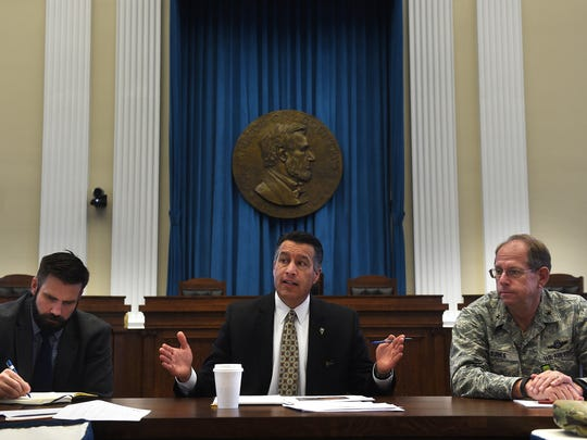 Governor Brian Sandoval, middle, speaks during a briefing on possible spring flooding at the Old Assembly Chambers in the Nevada State Capital Building in Carson City on April 13, 2017. Nevada Department of Public Safety Chief Caleb Cage is seen on the left and Brigadier General William Burks of the Nevada National Guard is seen on the right.