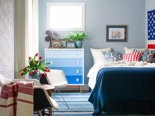 This light and airy vintage-style bedroom by Brian Patrick Flynn demonstrates the designer's use of blue-gray tones to keep rooms feeling classic and gender-neutral.