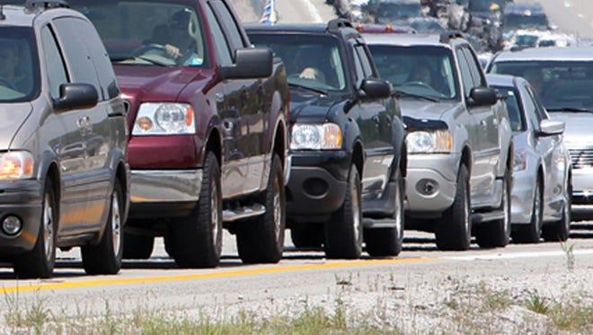 Cars sit in traffic