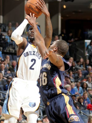 March 11, 2016 - Memphis Grizzlies Briante Weber shoots defined by New Orleans Pelicans Toney Douglas at FedExForum.