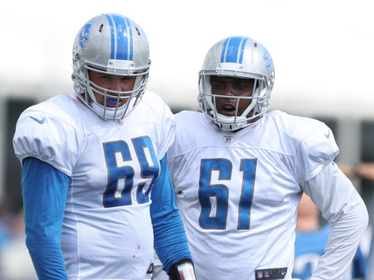 Lions defensive linemen Anthony Zettel, left, and Kerry Hyder watch drills Tuesday, August 1, 2017 in Allen Park.