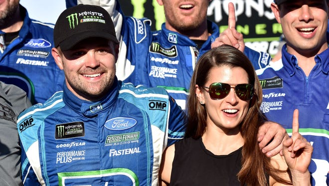Ricky Stenhouse Jr.   celebrates with girlfriend Danica Patrick Sunday in victory lane at Talladega Superspeedway.