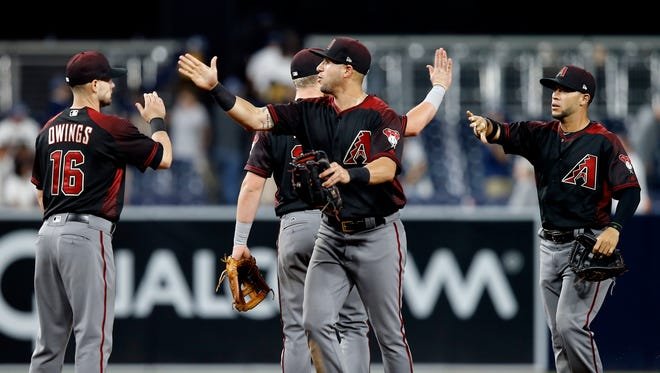 Arizona Diamondbacks celebrate defeating the San Diego Padres 9-1 after the ninth inning of a baseball game in San Diego, Saturday, May 20, 2017.