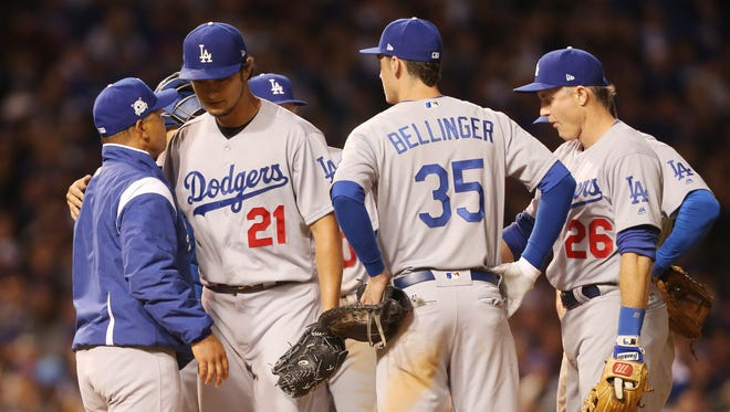 Yu Darvish is relieved by Dodgers manager Dave Roberts.