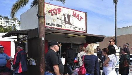 """Top Hat had the coolest sign in Ventura, and that's about it,"" says local restaurateur Jim Rice about the burger stand, seen on its final day of business in February 2010."