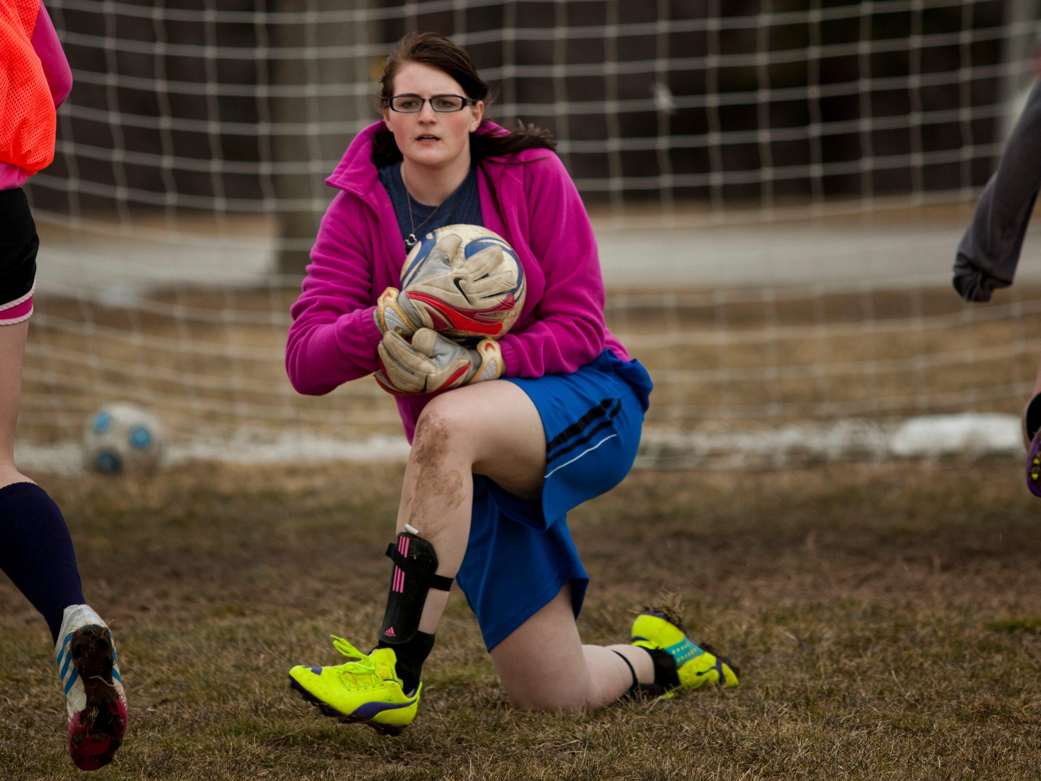 Junior goal keeper Sarah Compton stops a shot on goal during practice Thursday at Brockway Township Park.