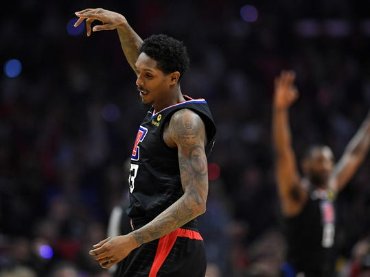 Los Angeles Clippers guard Lou Williams, left, celebrates after hitting a 3-point shot during the first half of the team's NBA basketball game against the Cleveland Cavaliers, Friday, March 9, 2018, in Los Angeles. (AP Photo/Mark J. Terrill)
