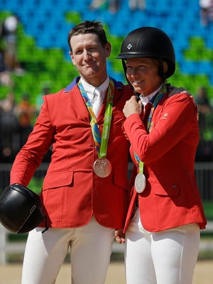 McLain Ward (left) and Beezie Madden celebrate after winning a silver medal in the equestrian team jumping competition at the 2016 Rio Games Aug. 17, 2016.