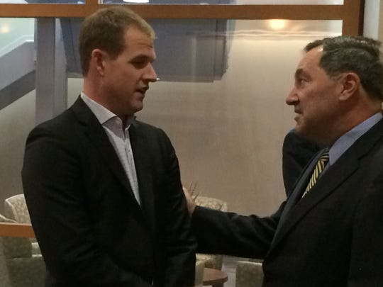 Brian Carrico of Innovative Health Solutions speaks with Sen. Joe Donnelly after a Heroin Is Here meeting at Reid Health.