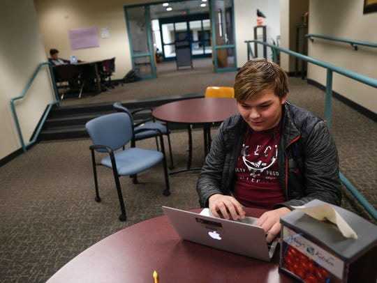 Second-year student Jacob Ledbetter works on his English homework on Friday at San Juan College High School in Farmington.