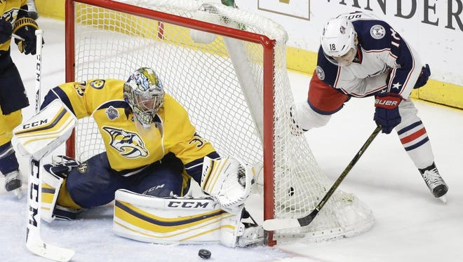 Predators goalie Pekka Rinne blocks a shot by Blue Jackets right wing Rene Bourque in the second period.