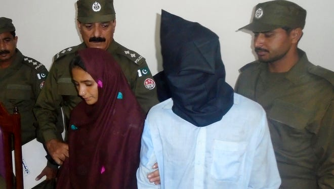21-year-old Aasia Bibi and her boyfriend, Shahid Lashari, speak to the media on Oct. 30, 2017, at a police station in Muzaffargarh, Pakistan. Pakistani police arrested Bibi, a woman married against her will, on murder charges after she allegedly poisoned her husband's milk and it inadvertently killed 17 other people in a remote village.