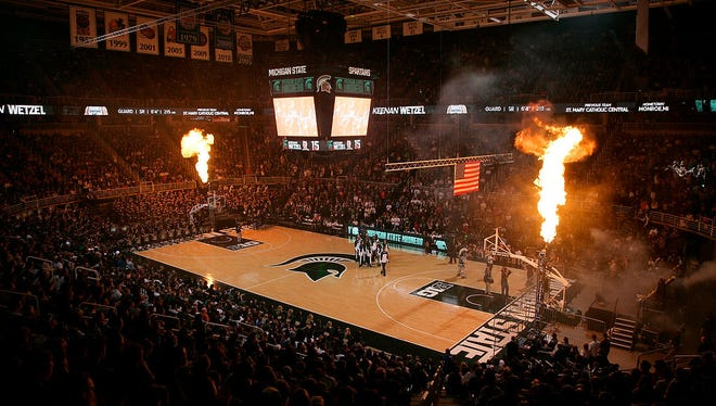 Pyrotechnics illuminate the Breslin Center as Michigan State players are introduced before an NCAA college basketball scrimmage, Friday, Oct. 24, 2014, in East Lansing, Mich.