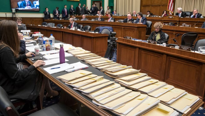 "Folders containing amendments to the GOP's ""Obamacare"" replacement bill are spread on a conference table on Capitol Hill in Washington, on March 9, 2017, as members of the House Energy and Commerce Committee worked through the night."