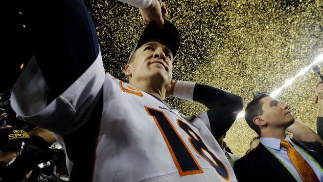 Denver Broncos' Peyton Manning (18) walks on the field after their win against the Carolina Panthers in the NFL Super Bowl 50 football game Sunday, Feb. 7, 2016, in Santa Clara, Calif. The Broncos won 24-10. (AP Photo/Julio Cortez)