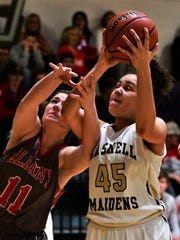 Haskell's C'Era Taylor and Albany's Chloe Fields battle for a loose ball during Haskell's 60-37 win over Albany in a district game on Tues., Feb. 6, 2018 in Haskell.
