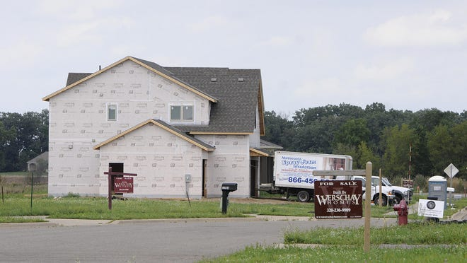 Home construction was underway in 2014 at a new neighborhood in Sartell. New construction helped increase Stearns County's market value and reduce its tax rate for 2016.