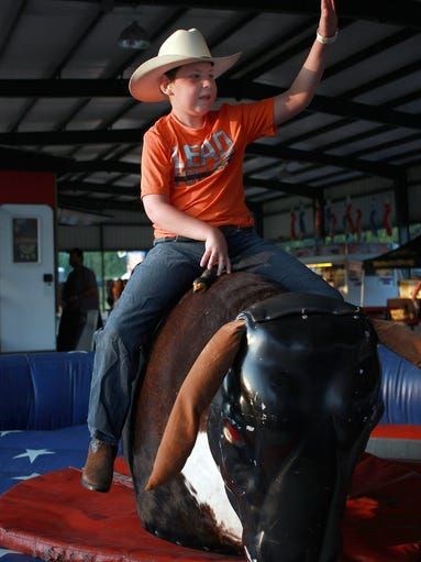 TJ Taylor one hands it as he rides the mechanical bull