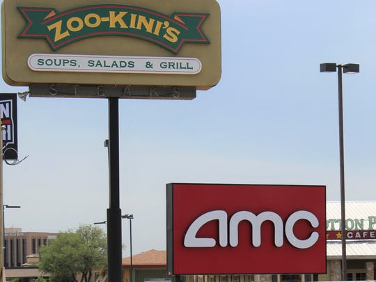 Two gone now ... the sign for Zoo-kini's, a long-closed restaurant that was demolished this week, stands near a sign for AMC, which closed its southwest Abilene movie theater Thursday.
