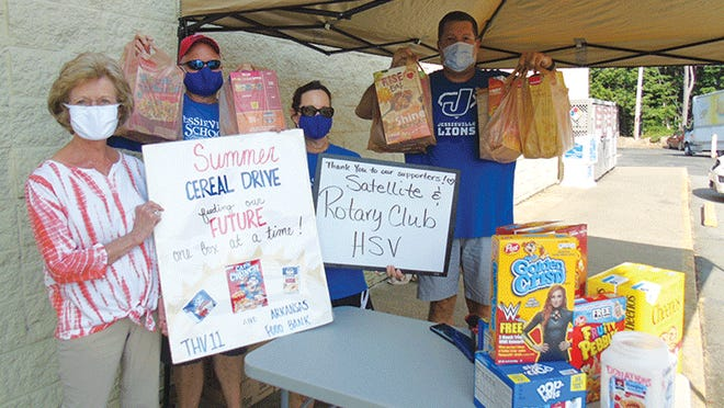 From left, Caryl Joy Young, brings cereal donations from Rotary Satellite Club to Jessieville School volunteers David and Brenda MacKay and Chris Davis, Jessieville technology assistant.