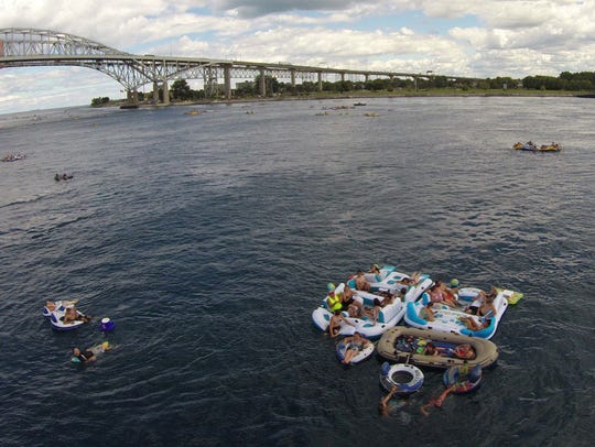 Floaters travel down the St. Clair River during Float